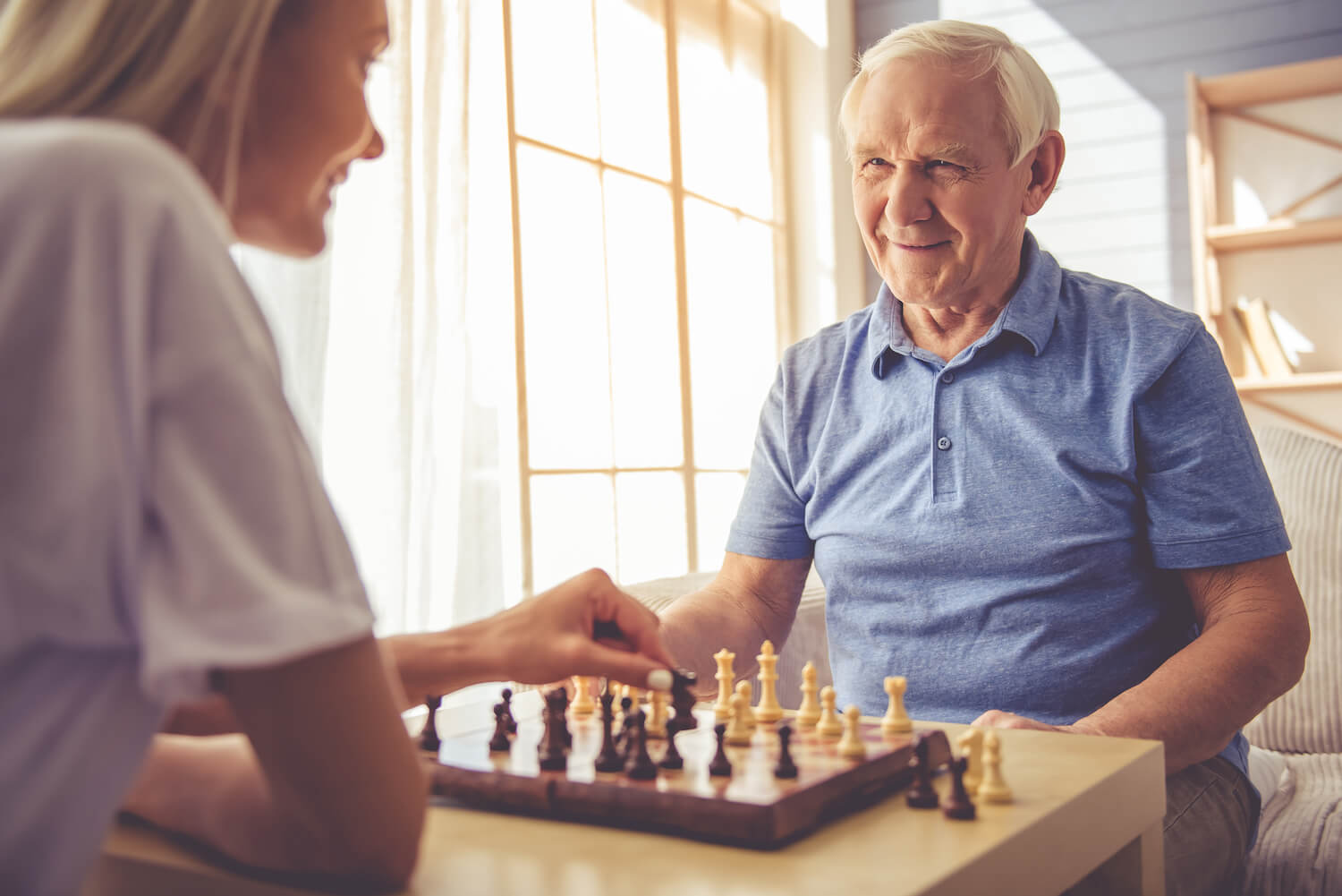 Providing Aging Parents to stay in their home and enjoy life and activities like playing chess.